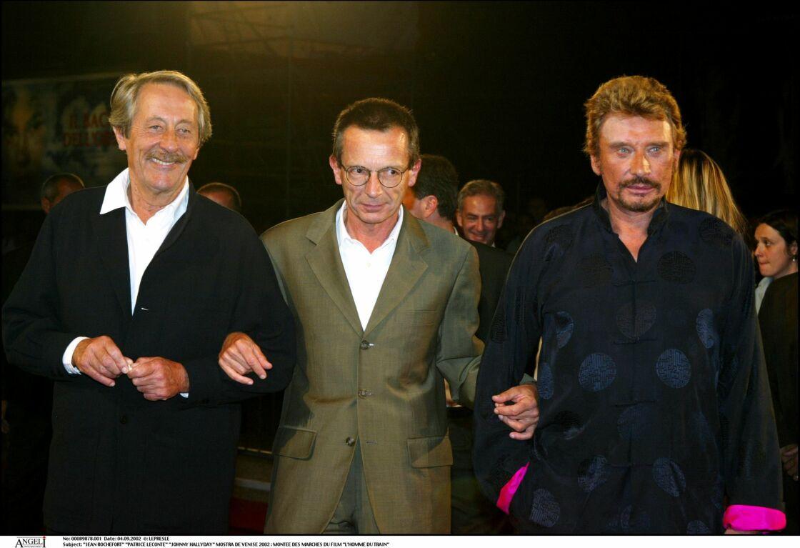 Patrice Leconte, entouré de Jean Rochefort et de Johnny Hallyday pour