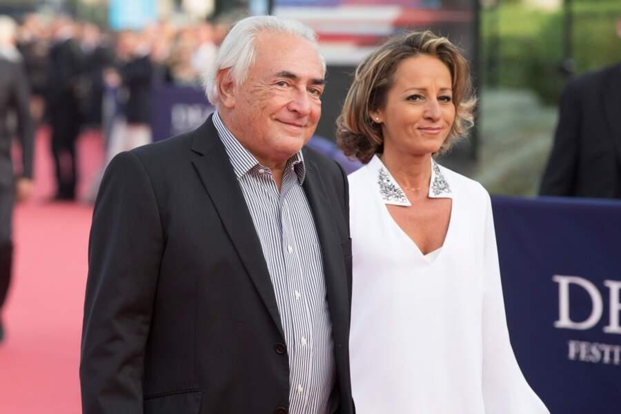 """Dominique Strauss-Kahn et Myriam L'Aouffir à l'avant-première du film """"Sin City"""" à Deauville, en 2014"""