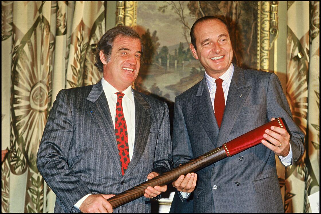 Jacques Chirac (ici avec Jean-Paul Belmondo), à Paris, le 23 décembre 1987.