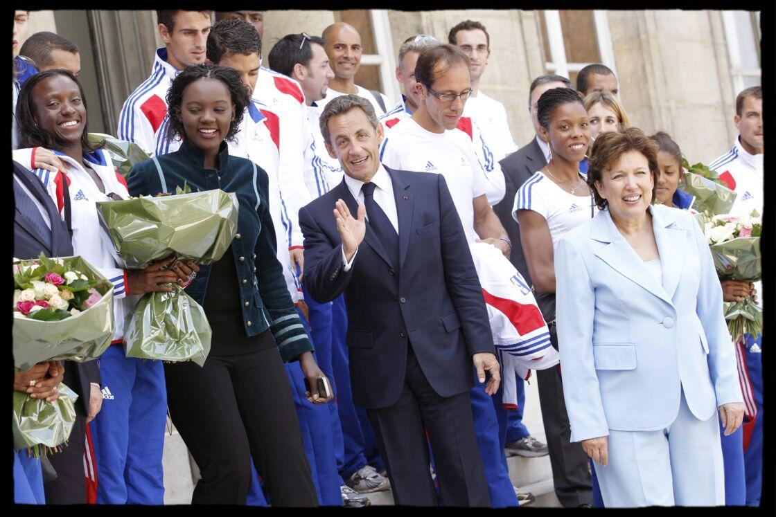 Nicolas Sarkozy, entouré de Rama Yade et Roselyne Bachelot pour accueillir les médaillés français au Palais de l'Elyséee, en 2010.