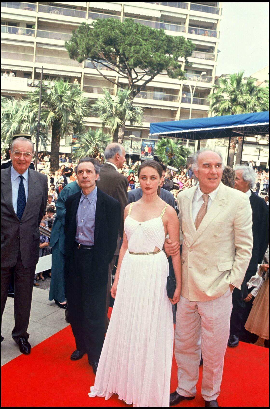 Jacques Rivette, Emmanuelle Béart et Michel Piccoli au festival de Cannes en 1991.