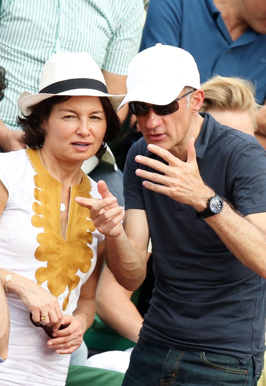 Gilles Bouleau et sa femme, à Roland Garros, en juin 2014.