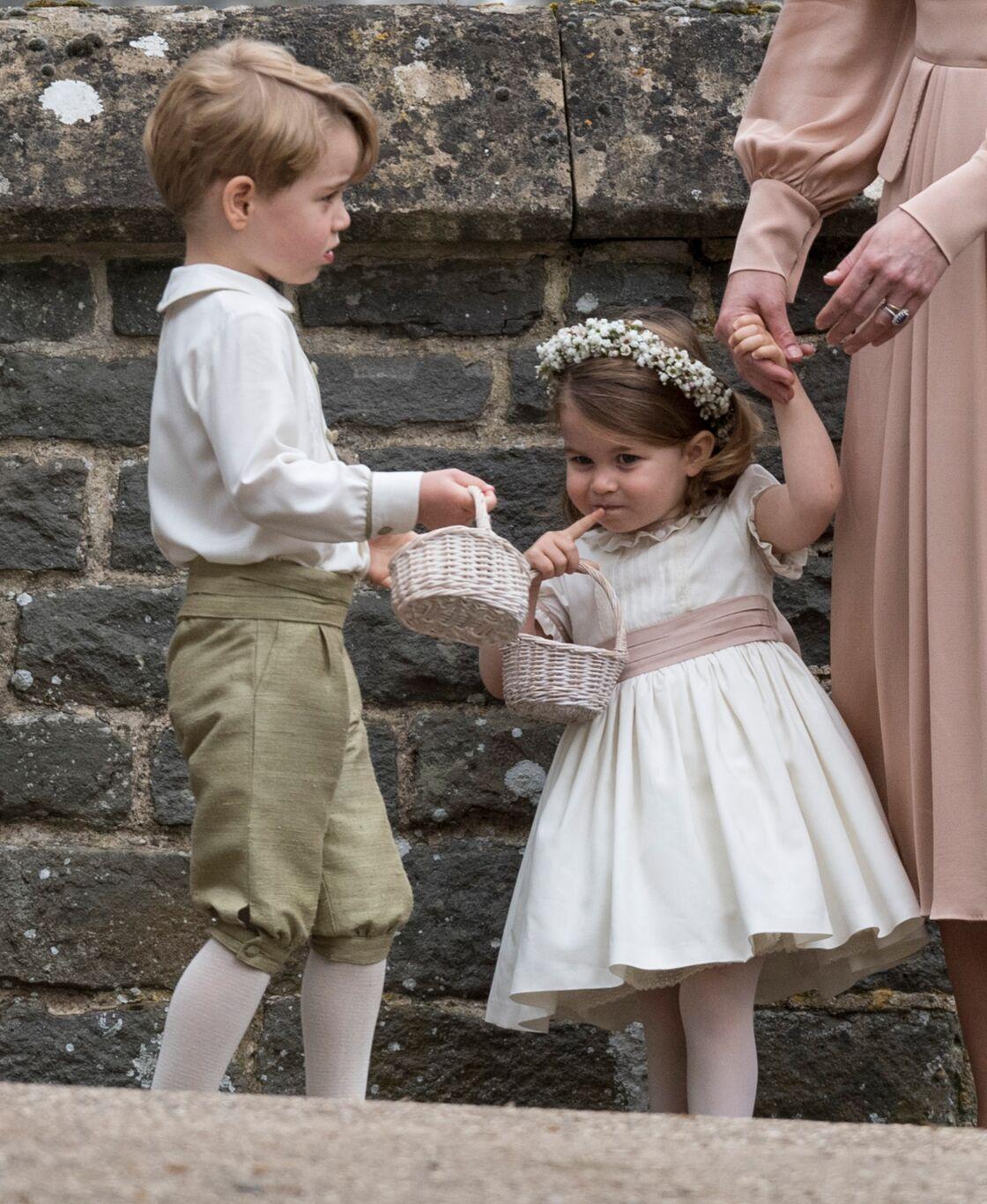 Le prince George et la princesse Charlotte lors du mariage de leur tante Pippa Middleton, en mai 2017.