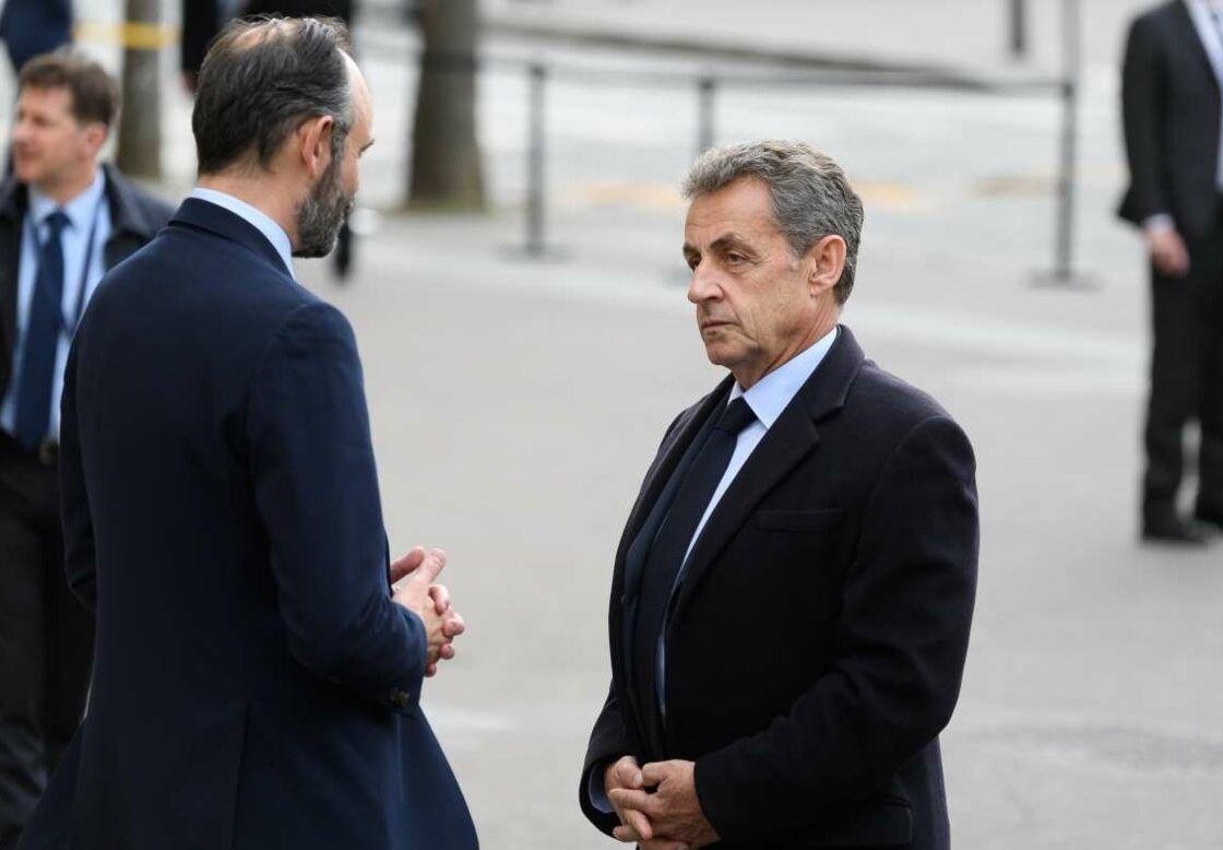 Nicolas Sarkozy et Édouard Philippe, lors de la journée nationale d'hommage aux victimes du terrorisme sur l'Esplanade du Trocadero à Paris, le 11 mars 2020.