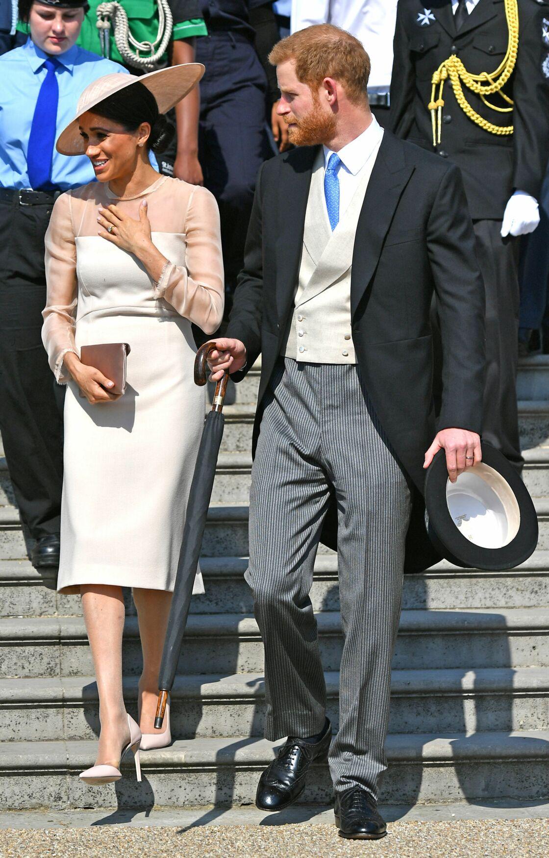 Le prince Harry, duc de Sussex, et Meghan Markle, duchesse de Sussex, lors de la garden party pour les 70 ans du prince Charles au palais de Buckingham à Londres, le 22 mai 2018
