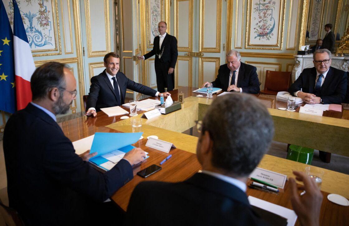 Édouard Philippe, Emmanuel Macron, Gérard Larcher et Richard Ferrand en réunion de travail à l'Élysée, la veille du changement de Premier ministre, le 2 juillet 2020.