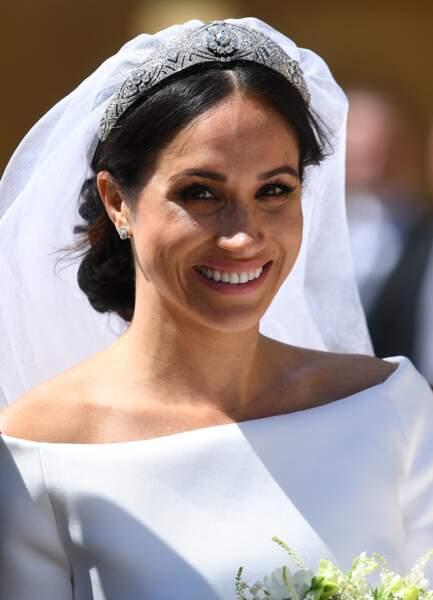 Ses boucles d'oreilles Cartier : Meghan Markle a choisi ce modèle en or blanc et diamantq pour son mariage, mais on l'a vu les porter à d'autres reprises
