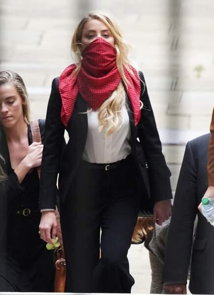 Amber Heard arrive à la Cour Royale de justice à Londres dans le cadre d'un procès en diffamation contre le journal The Sun le 9 juillet 2020.