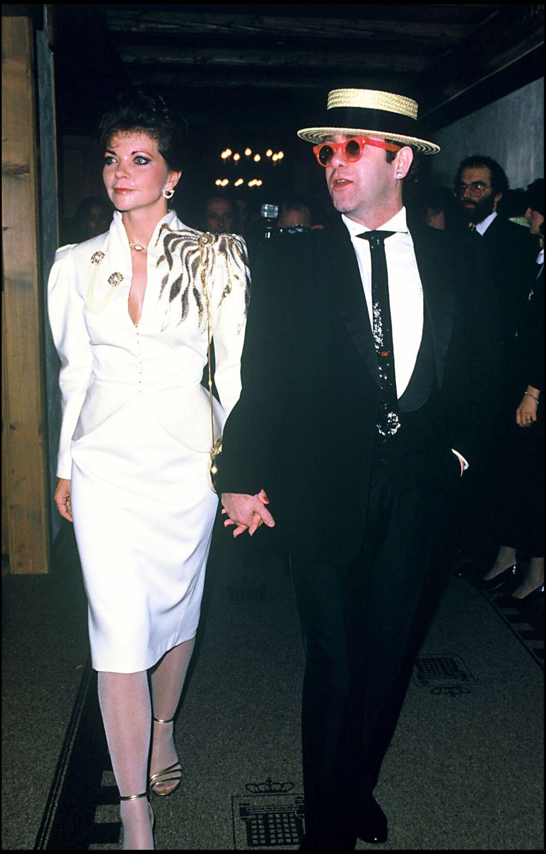Renate Blauel et Elton John, en 1985.