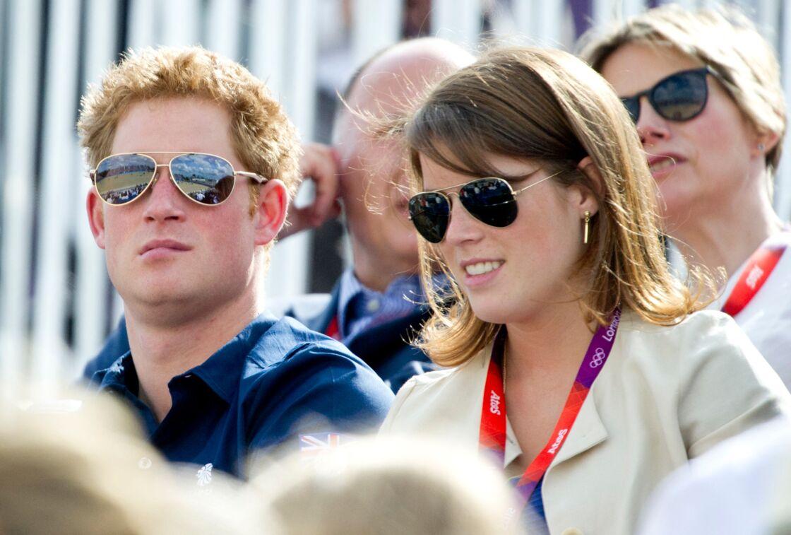 Le prince Harry et la princesse Eugenie réunis dans les tribunes des Jeux Olympiques de Londres en 2012.