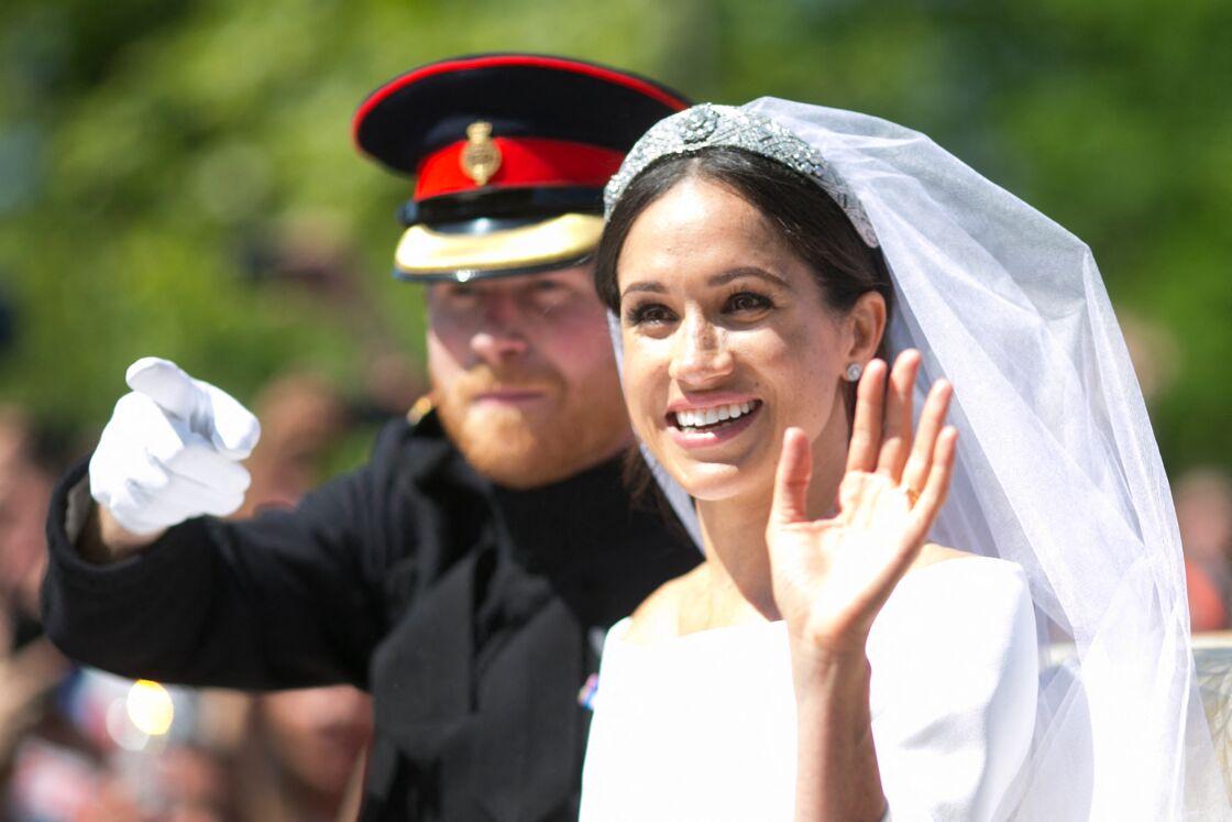 Le prince Harry et Meghan Markle en calèche au château de Windsor après leur mariage au château de Windsor, le 19 mai 2018.