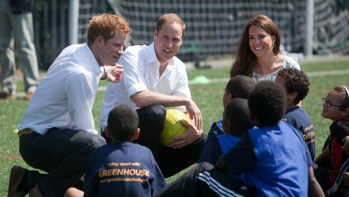 Kate, Harry et William en visite au collège Bacon à Rotherhithe, en juillet 2012
