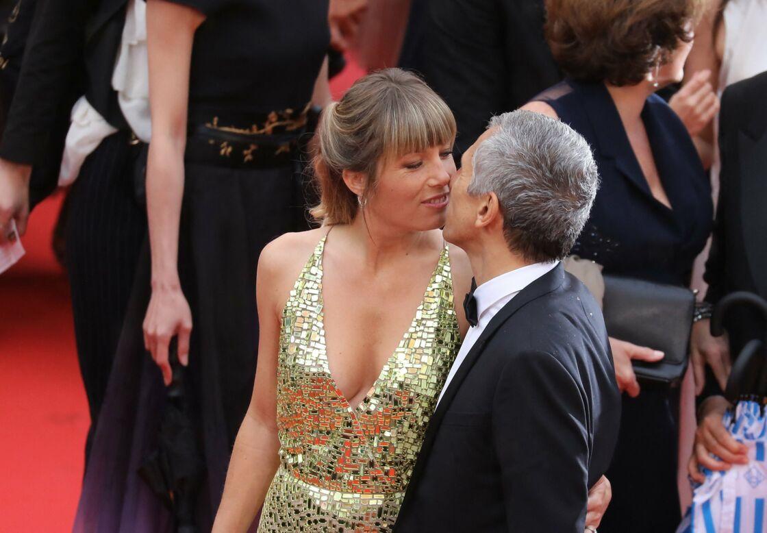 Baiser volé sur le tapis rouge du Festival de Cannes, en 2019. Nagui et Mélanie Page, sans céder au show-off, assument leurs sentiments.