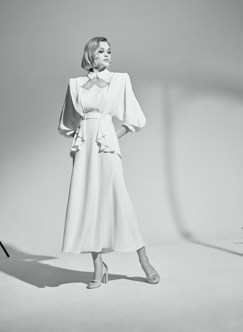 La robe de mariée de Natalia Vodianova est signée Ulyana Sergeenko Couture, collection Automne-Hiver 2020.