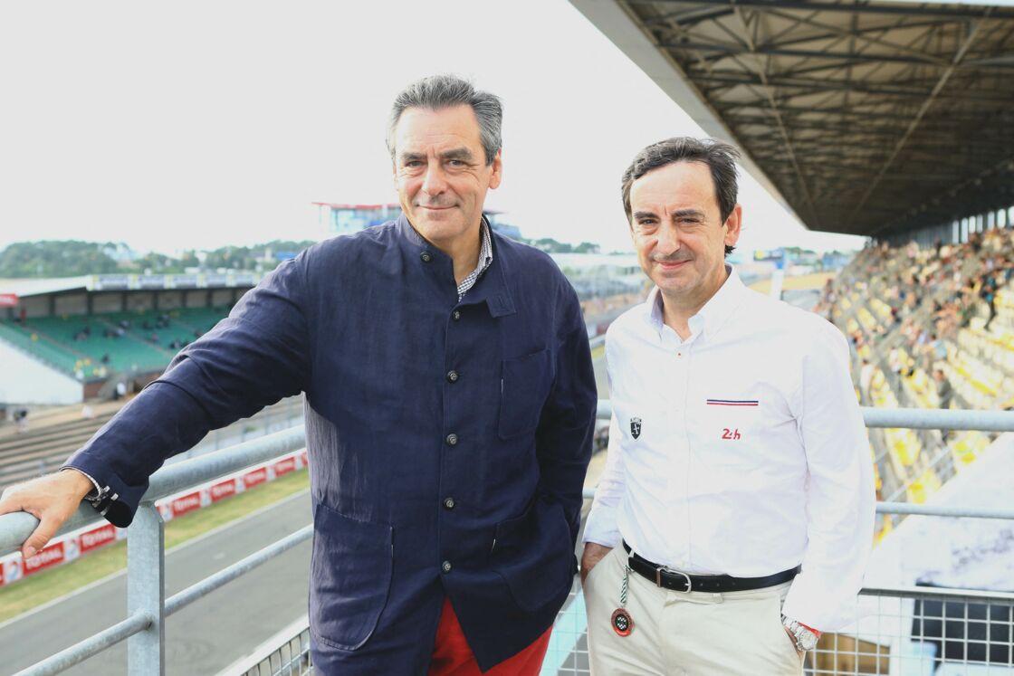 François Fillon prend la pose à côté de l'un de ses frères, Pierre, lors de l'édition 2014 de Le Mans Classic.
