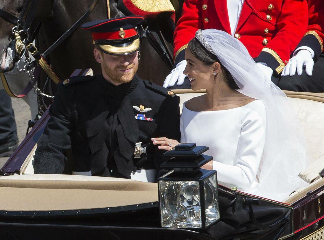 Le prince Harry et Meghan Markle en calèche après leur mariage au château de Windsor, le 19 mai 2018.