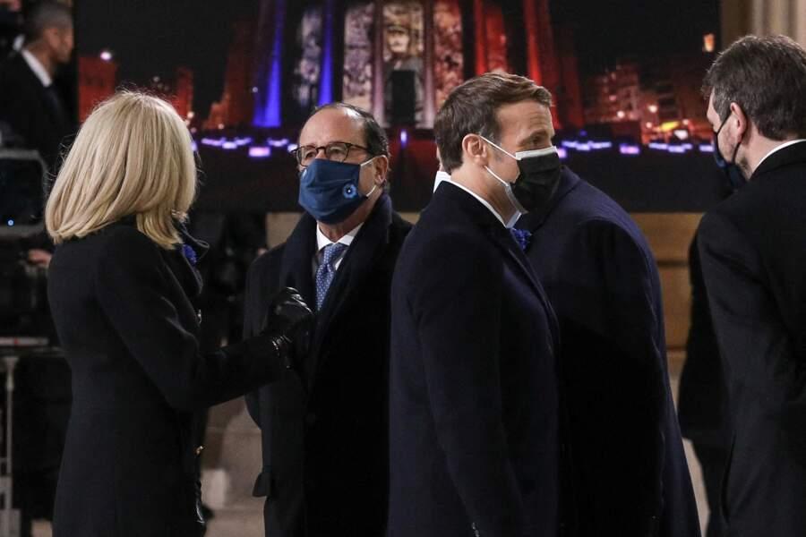 La première dame Brigitte Macron en grande conversation avec François Hollande