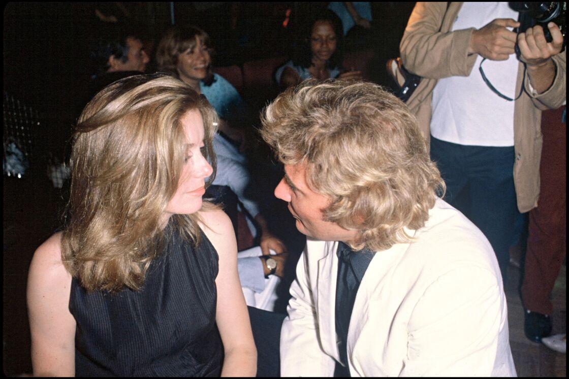Catherine Deneuve et Johnny Hallyday en soirée pour le 38ème anniversaire de Johnny Hallyday