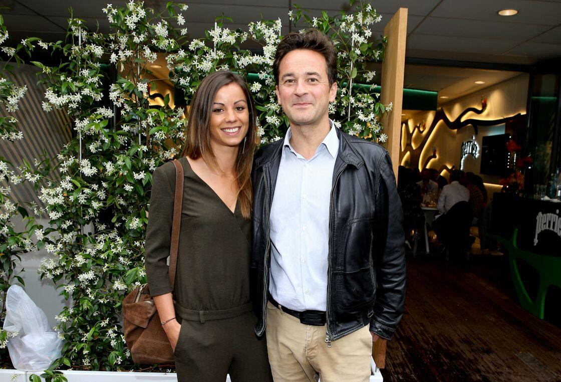 Nathanaël de Rincquesen et sa compagne Caroline au village lors des internationaux de France de tennis de Roland Garros, Jour 3, à Paris le 29 mai 2018.