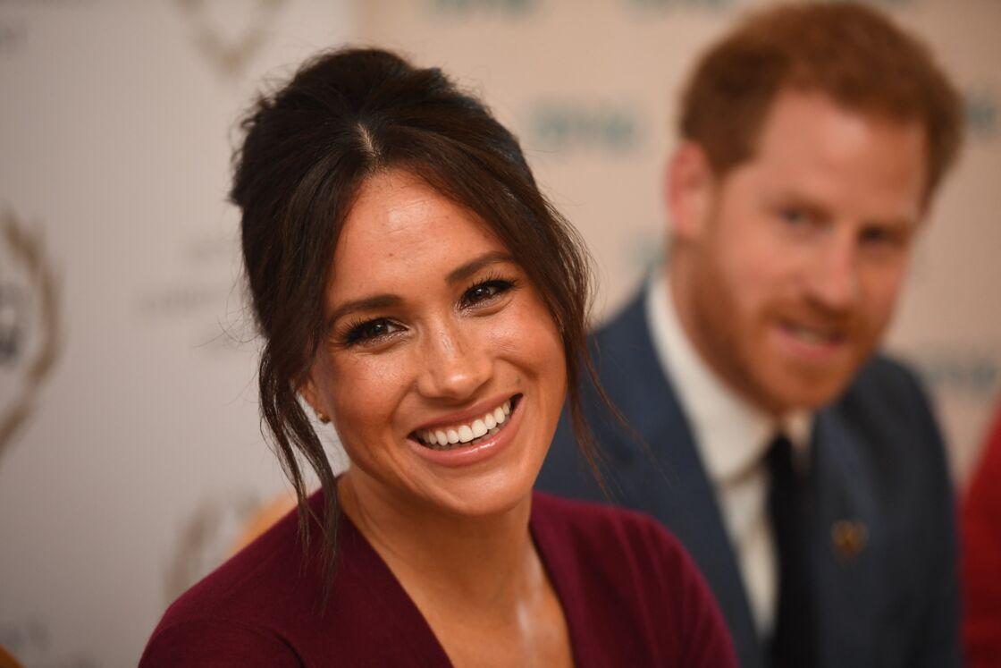 Le prince Harry, duc de Sussex, et Meghan Markle, duchesse de Sussex, participent à une réunion sur l'égalité des genres avec les membres du Queen's Commonwealth Trust (dont elle est vice-présidente) et du sommet One Young World au château de Windsor, le 25 octobre 2019.