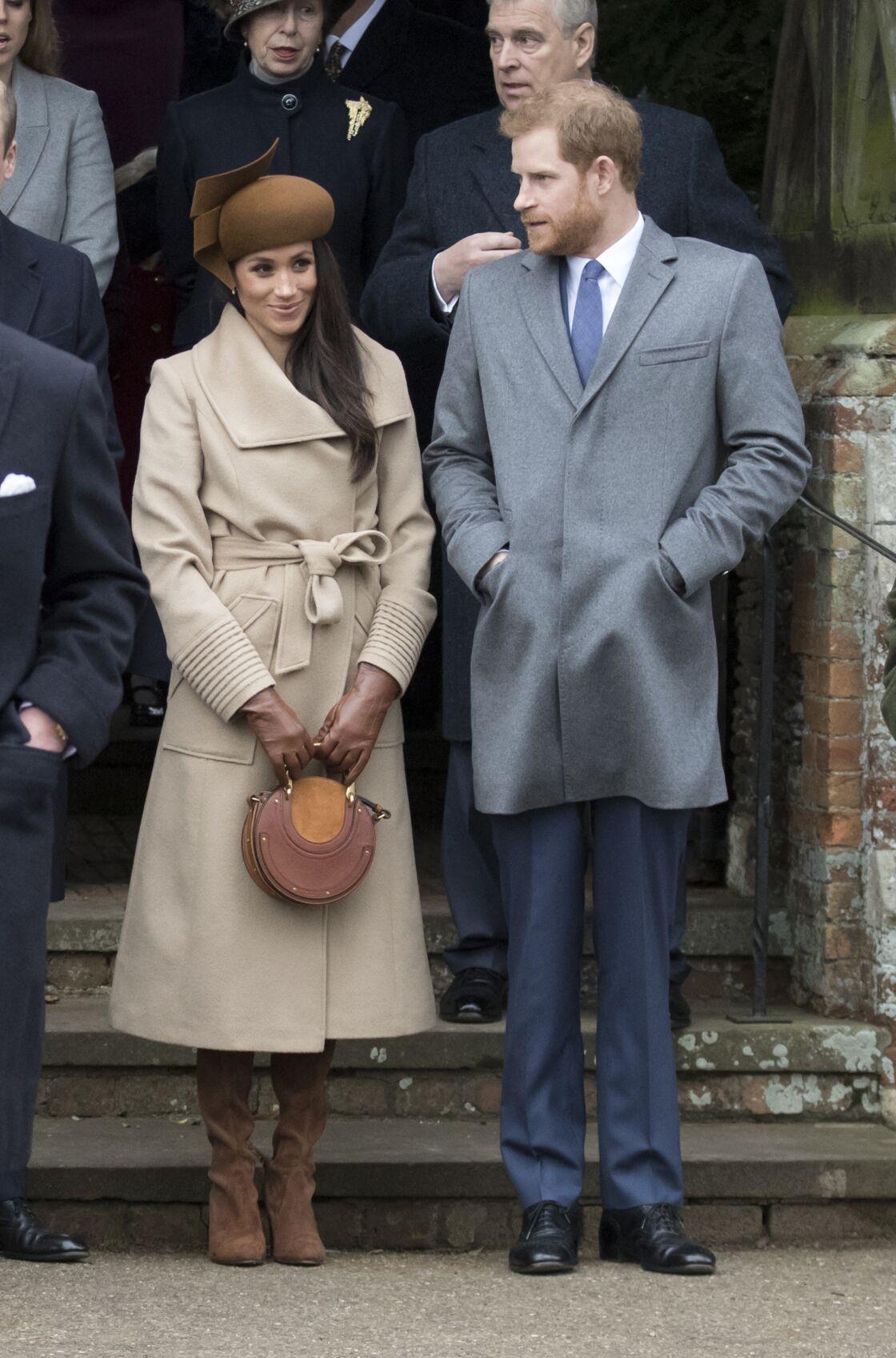 Meghan Markle et le prince Harry arrivant à la messe de Noël le 25 décembre 2017