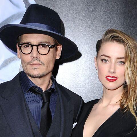 Johnny Depp retourne sa veste pour Amber Heard