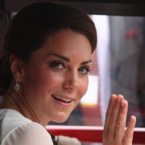 Photos- Kate Middleton tâche de garder le sourire
