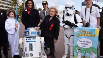 Photos- Bernadette Chirac caste R2D2 pour l'Opération Pièces jaunes