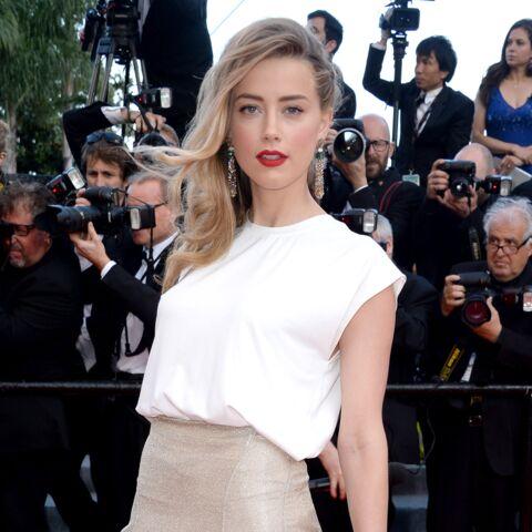 Cannes 2014: Amber Heard, Marion Cotillard montent les marches pour Deux jours, une nuit