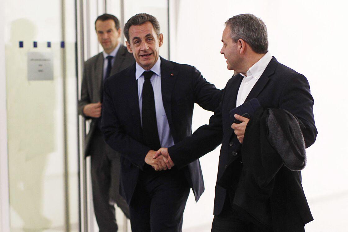 Nicolas Sarkozy et Xavier Bertrand au siège de l'UMP, rue de Vaugirard, le 1er décembre 2014