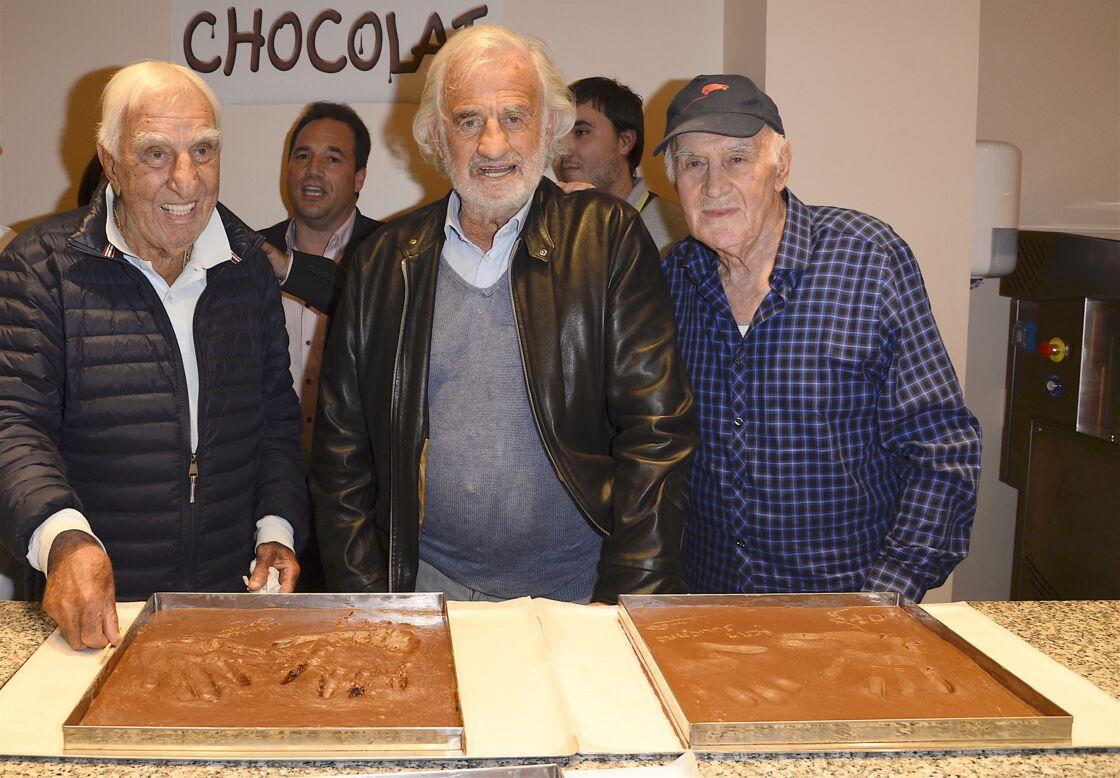 Charles Gérard, Jean-Paul Belmondo et Rémy Julienne le 15 juin 2016 au musée gourmand du chocolat à Paris
