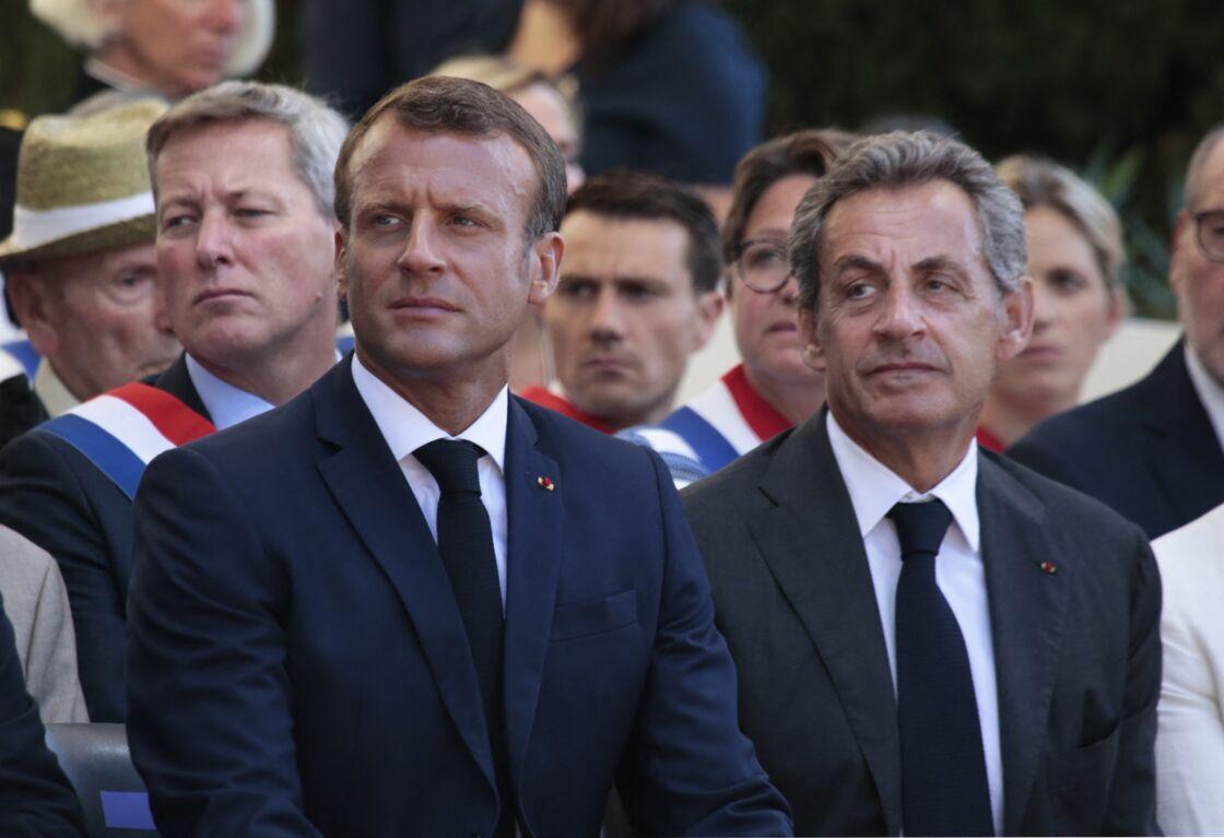 Le président Emmanuel Macron, Nicolas Sarkozy lors du 75ème anniversaire du débarquement en Provence pendant la seconde guerre mondiale à Saint-Raphaël le 15 août 2019