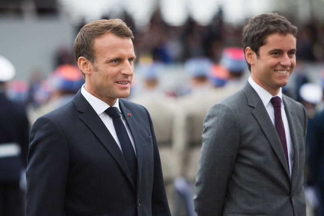 Emmanuel Macron et Gabriel Attal sur les Champs-Élysées à Paris, le 14 juillet 2019