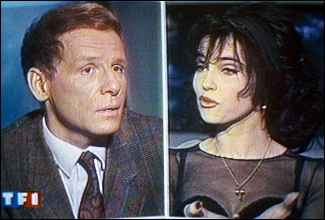 Patrick Poivre d'Arvor et Béatrice Dalle dans le journal télévisé de TF1 le 12 mars 1992