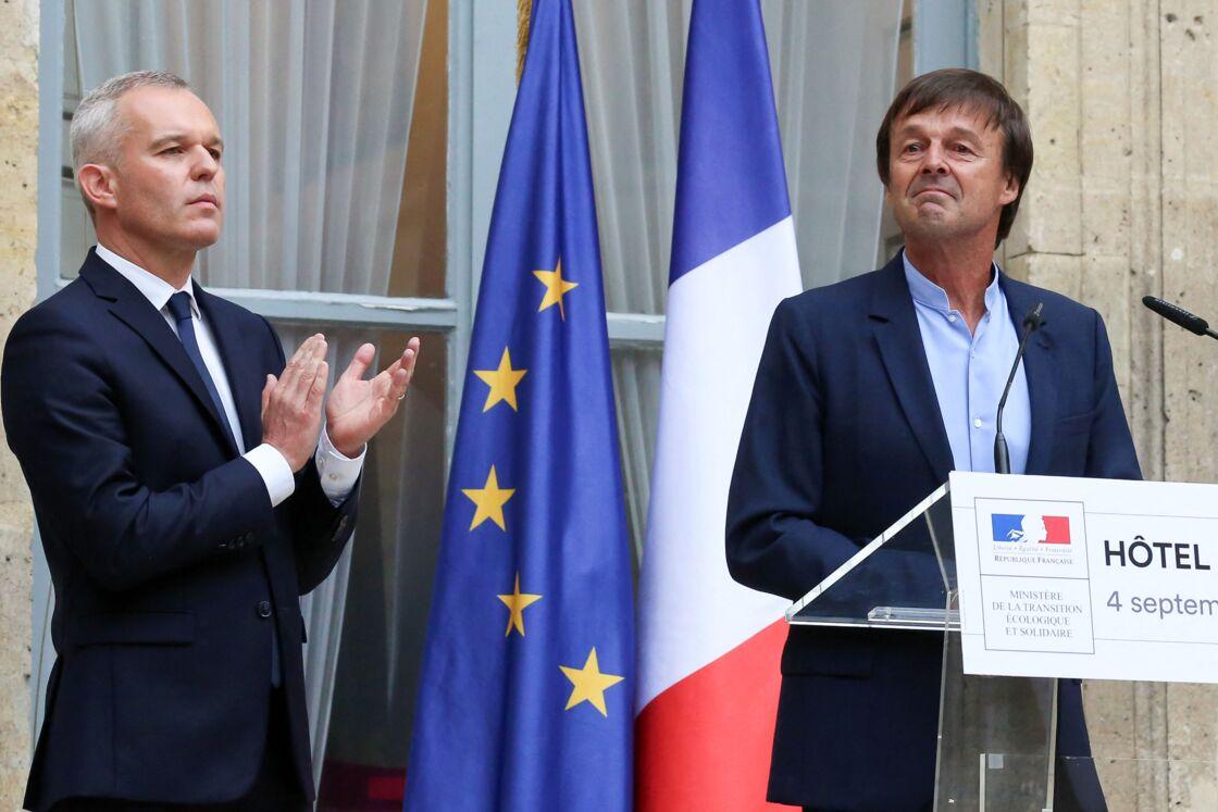 Nicolas Hulot et son successeur François de Rugy, au ministère de l'Ecologie, hôtel de Roquelaure, à Paris, le 4 septembre 2018.