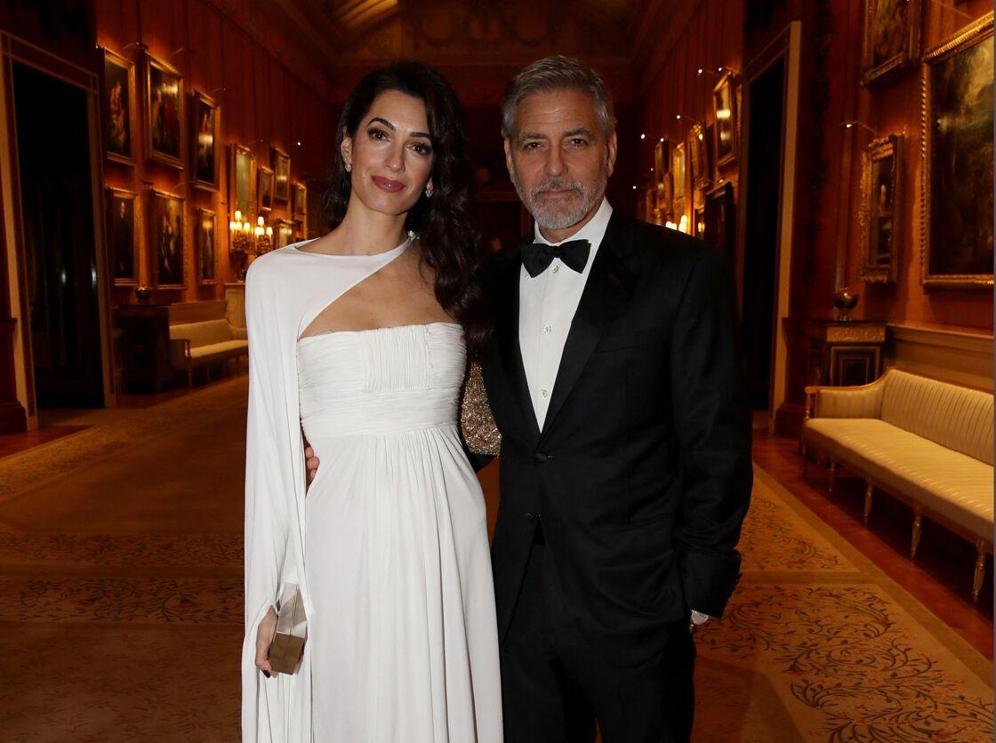 Georges et Amal Clooney au Buckingham Palace, le 12 mars 2019