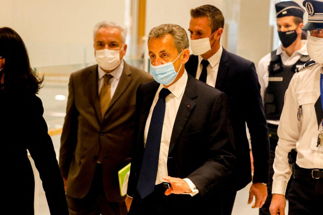 Nicolas Sarkozy arrive pour son jugement sur l'affaire des écoutes, le 1er mars 2021, au tribunal de Paris