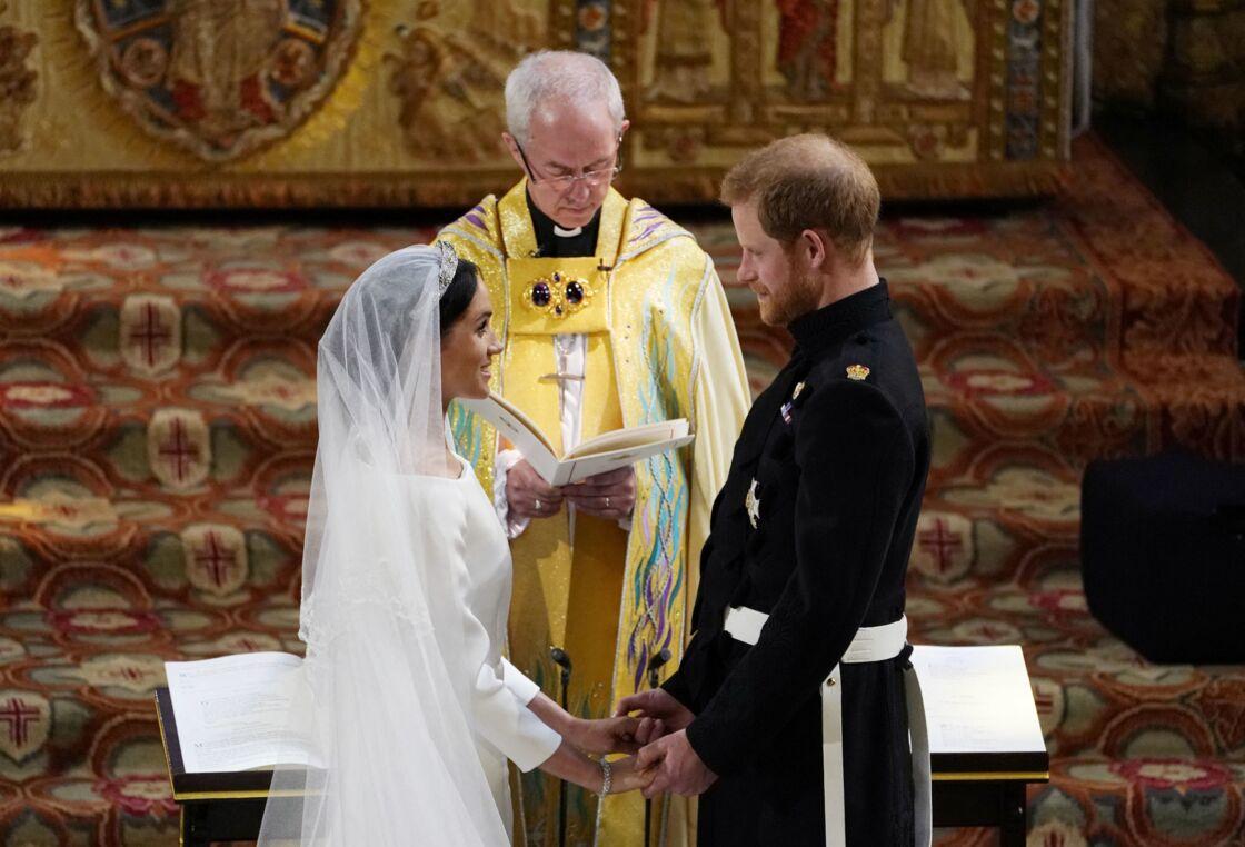 Meghan Markle et le prince Harry lors de leur mariage devant l'archevêque Justin Welby, le 19 mai 2018