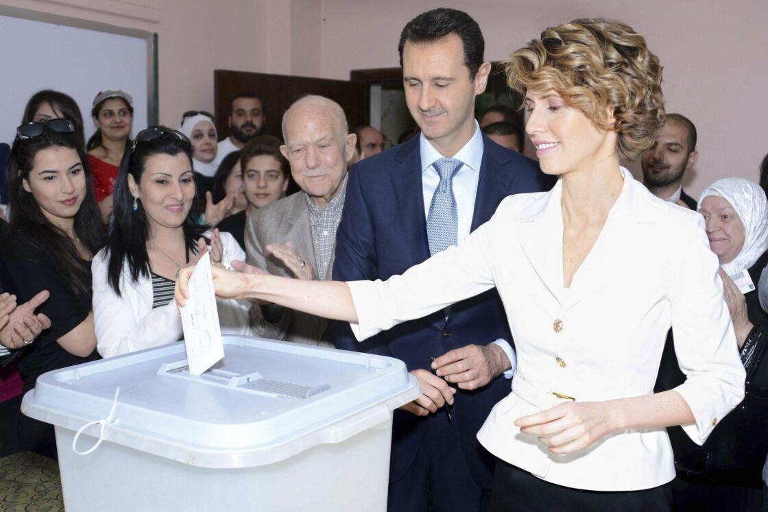 Bachar Al-Assad, le président syrien, est allé voté avec sa femme asma le mardi 3 juin pour l'élection présidentielle, qui s'apparente plus à une consultation en trompe-l'œil qu'à un véritable vote., en 2014