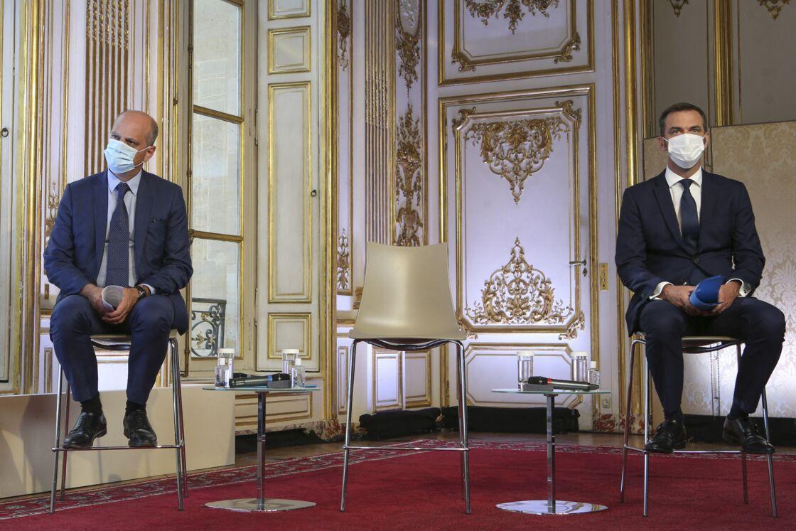 Jean-Michel Blanquer au côté d'Olivier Véran, lors d'une conférence de presse sur l'épidémie de Covid-19, à l'Hôtel de Matignon, à Paris, le 27 août 2020.