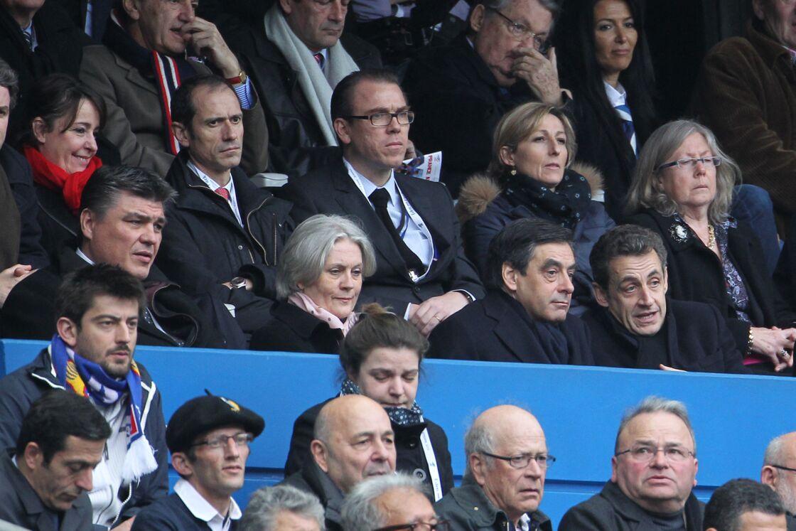 Nicolas Sarkozy, François Fillon et son épouse Penelope Fillon, en mars 2012 au Stade de France