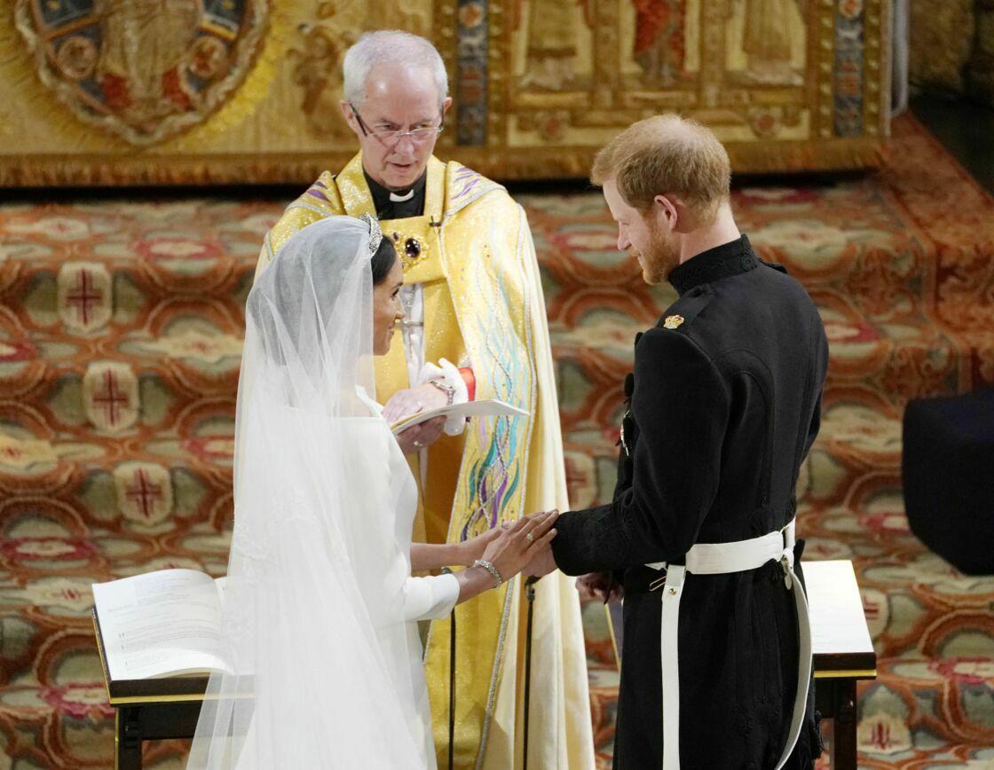 Le prince Harry et Meghan Markle en compagnie de l'archevêque de Canterbury lors de leur mariage le 19 mai 2018
