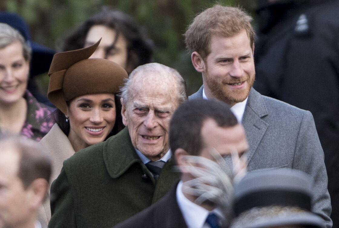 Le prince Philip entourée de Meghan Markle et du prince Harry, pour la messe de Noël le 25 décembre 2017