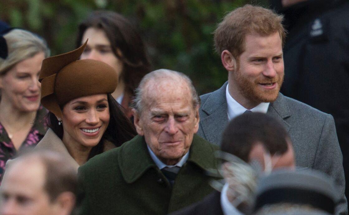 Meghan Markle, le prince Harry et le prince Philip en direction de l'église Sainte-Marie-Madeleine à Sandringham, le 25 décembre 2017