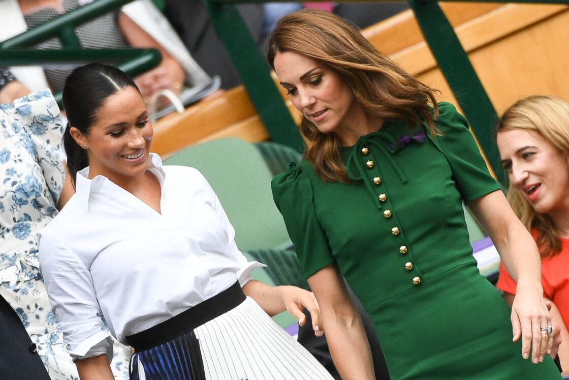 Meghan Markle et Kate Middleton dans les tribunes de Wimbledon, à Londres le 13 juillet 2019.