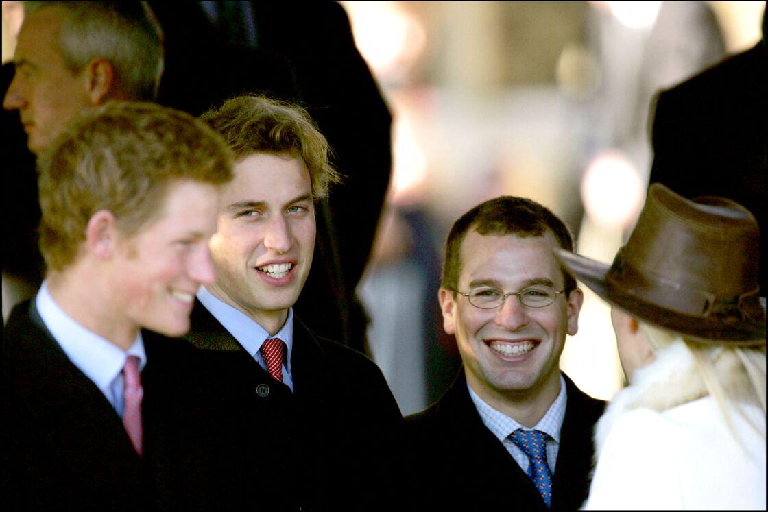 Les princes Harry et William et leur cousin Peter Philips en décembre 2004