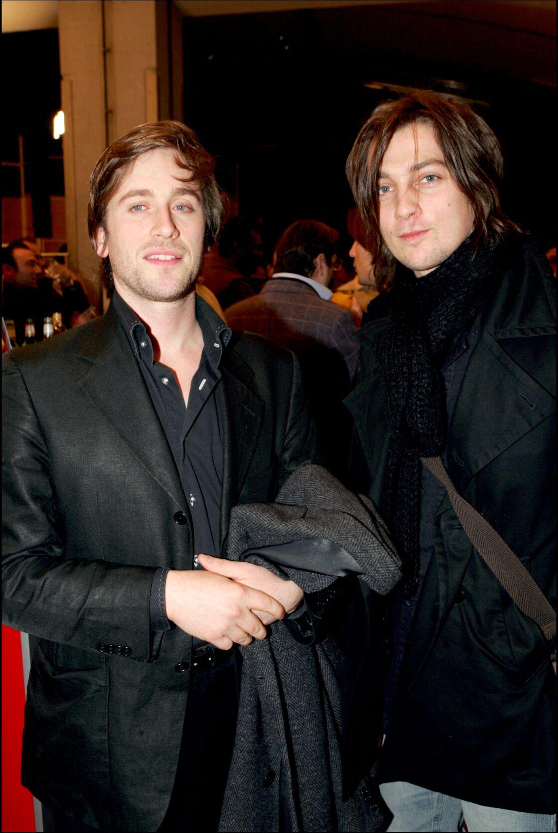 Thomas Dutronc avec le père de la fille de Zazie, Fabien Cahen, le 31 janvier 2005