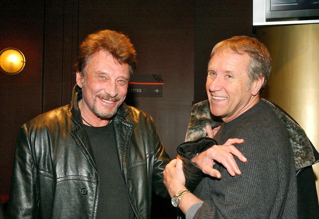 Johnny Hallyday et Yves Rénier à Paris, en 2005.