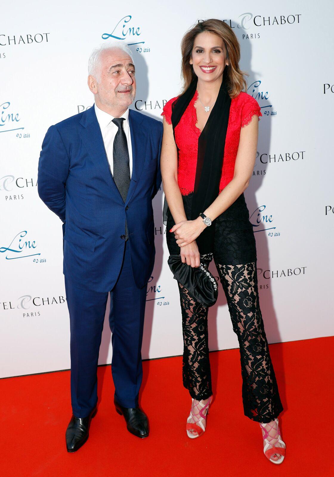Guy Savoy et Sonia Mabrouk assistent ensemble au 90ème anniversaire de Line Renaud, à Paris, le 2 juillet 2018.