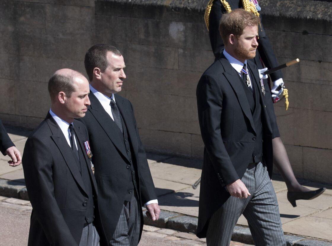 Le prince Harry, Peter Phillips et le prince William, aux funérailles du prince Philip, à la chapelle Saint-Georges du château de Windsor, le 17 avril 2021.